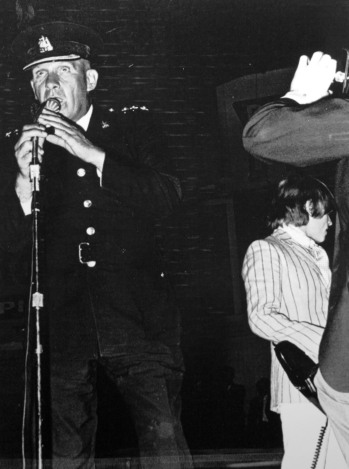 Inspector Bud Errington on stage with the Rolling Stones at the Forum, 19 July 1966. Photo: Vancouver Police Museum