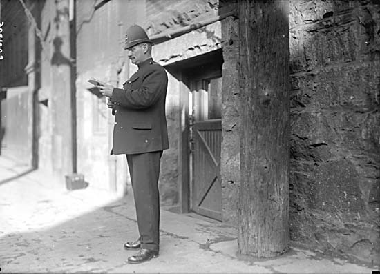 A police constable in Market Alley, 1925. Photo: City of Vancouver Archives #SGN 386