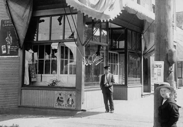 Windows broken at 201 Powell Street in Japantown during the 1907 Asiatic Exclusion League Riots. Although there was significantly more damage done in Chinatown, Japanese claims for government compensation came much quicker because Canada was trying to build diplomatic relations with Japan. Japan's defeat of a European power - Russia - in 1905, led to other European states treating it as a serious force on the international stage. Photo: Library and Archives Canada #C023555