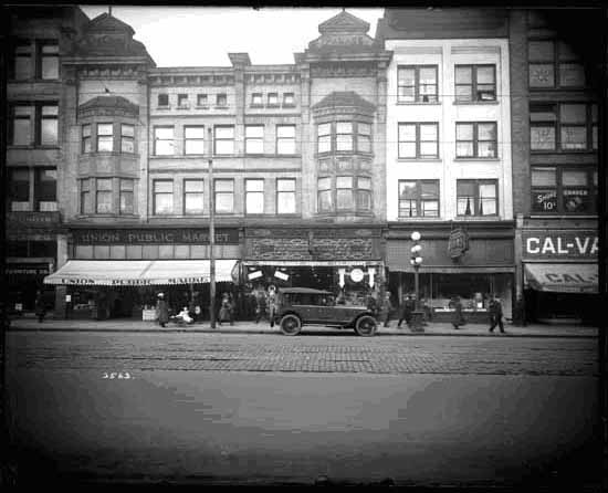 Allen's Cafe at 27 West Hastings (the white building on the right) was one of the cafes targeted by the unemployed in 1923. Vancouver Public Library #20986