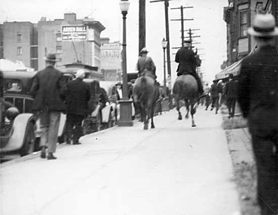 Cops chasing protesters, 18 June 1935