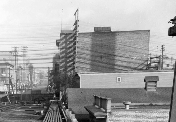 Construction of the first Georgia Viaduct, looking east toward Main Street, around 1913. The big building on the right is the rear of the Avenue Theatre. The top of 102 East Georgia can be seen just below it. City of Vancouver Archives #LGN 1188 (cropped)