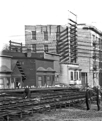 """A rare photo showing the former brothels on the north side of Shore Street after the 1912 relocation of the """"restricted district""""  to Alexander Street, during the construction of the original Georgia Viaduct. CVA #LGN 1188 (cropped)"""