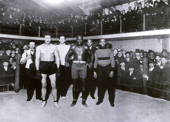 Victor McLaglen, Jack Johnson, and George Paris at the Vancouver Athletic Club, 1909. Paris put up Johnson and his white girlfriend at his house because Vancouver hotels wouldn't take in a mixed-race couple. Paris maintained a relationship with Johnson that included travelling to Europe as his personal trainer in 1914, and may have been introduced to the early jazz scene through Johnson.